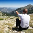 Person Relax on Top of a Mountain Against Great Panorama — Stock Photo #4799335