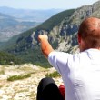 Person Relax on Top of a Mountain Against Great Panorama — Stock Photo #4799372