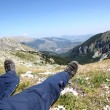 Person Relax on Top of a Mountain Against Great Panorama — Stock Photo #4799566