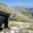 Person Relax on Top of a Mountain Against Great Panorama — Stock Photo #4799577