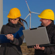 Two Engineers in Wind Turbine Power Generator Station — Stock Photo #4884701