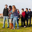 College Students Walking and Talking at Park — Stock Photo