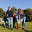College Students Walking and Talking at Park — Stock Photo #4933379