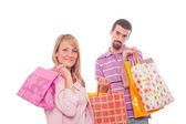 Pareja joven con bolsas de compras — Foto de Stock