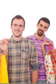 Young Homosexual Couple with Shopping Bags — Stock Photo