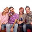 Stock Photo: Young Group Watching TV on Sofa