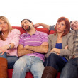 Bored Girls while Man Sleeping on Sofa - Stock Photo