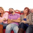 Stock Photo: Bored Girls while Man Sleeping on Sofa