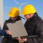 Two Engineers in Wind Turbine Power Generator Station — Stock Photo #5099995