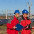 Royalty-Free Stock Photo: Engineers at Work In a Solar Power Station