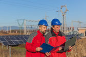 Engineers at Work In a Solar Power Station — Stock Photo