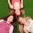 Young Girls Lying on the Ground — Stock Photo