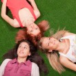 Young Girls Lying on the Ground — Stock Photo #5250035