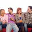 Young Group Sitting on Sofa and Drinking — Stock Photo #5250083