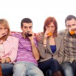 Young Group Sitting on Sofa and Drinking — Stock Photo #5250086