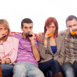 Royalty-Free Stock Photo: Young Group Sitting on Sofa and Drinking