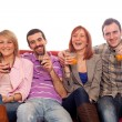 Young Group Sitting on Sofa and Drinking — Stock Photo #5250087