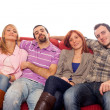 Four Boys and Girls Relaxing on Sofa - Stock Photo