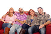 Four Boys and Girls Relaxing on Sofa — Stock Photo