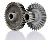 Gears connecting on white background. Two objects. — Stock Photo