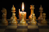 Chess and candle — Stock Photo