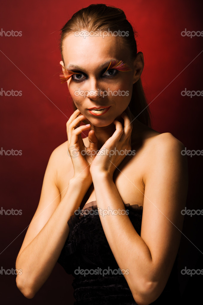 Glamour portrait of young fashion model with face art — Stock Photo #4429973