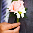 Buttonhole with rose detail of groom's wedding dressup — Stock Photo #4430425