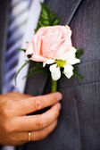 Buttonhole with rose detail of groom's wedding dressup — Stock Photo