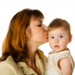 Mother kissing daughter — Stock Photo #4872246
