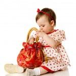 Girl holding purse — Stock Photo