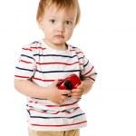 Boy holding toy — Stock Photo