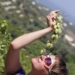 Woman smells grapes — Stock Photo #3992699