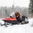 Russian woman driving snowmobile — Stock Photo