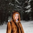 Woman in winter park - Stockfoto