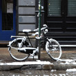 Stock Photo: Bicycle covered snow