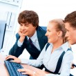 Three young successful businesspeople. Screen has a clipping pat - Foto Stock