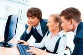 Three young successful businesspeople. Screen has a clipping pat — Stock Photo