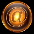 Stock Photo: Email icon gold, isolated on black background