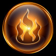 Royalty-Free Stock Photo: Fire icon gold isolated on black background