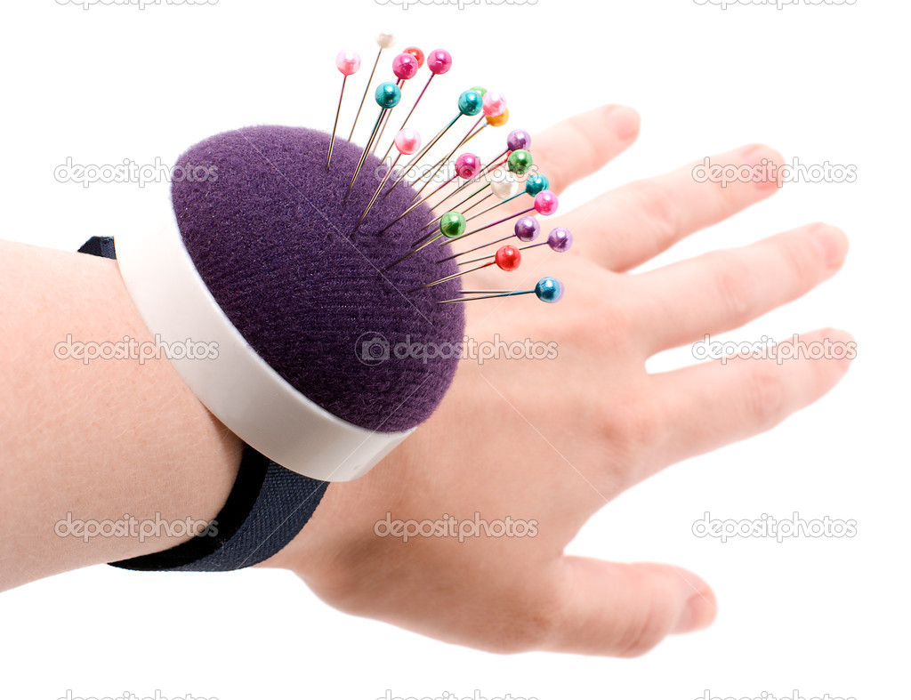 Purple pincushion bracelet with pins on the wrist,  isolated on white — Stock Photo #4645318