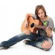 Teenager girl playing an acoustic guitar — Stock Photo