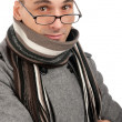 Attractive male wearing a coat and scarf — Stock Photo