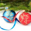 Christmas baubles with curly ribbon and christmas tree — Stock Photo