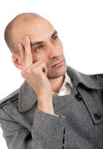 Thoughtful young man looking away — Stock Photo