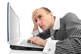 Worried businessman with computer — Stock Photo