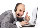 Customer services man with his laptop computer — Stock Photo