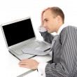 Young worried businessman with a laptop — Stock Photo #4327676