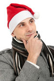 Man wearing a Santa Claus hat — Foto de Stock