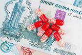 Pills and money — Stock Photo