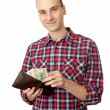 Man holding some dollars — Stock Photo